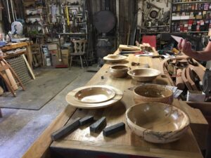 Green woodworking projects on table.